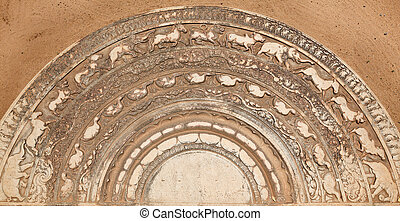 Ancient moonstone at the entrance of Buddhist dagoba...