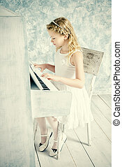 music lesson - Beautiful eight year old girl in white dress...