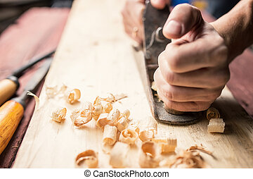 Man working with hand jack plane, close up photo