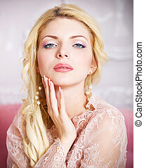 Portrait of young beautiful caucasian blond girl