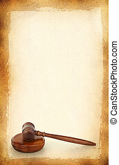 wooden gavel against old dirty background burned on edges