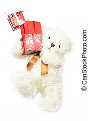 Creamy bear keeping gifts balancing on the one leg