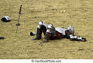 Down for the Count - Defeated knight lays immobilized after...