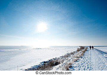 people walking in winter Marken a small village near...