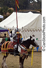 Preparing for the Joust - Knight in armor prepares for the...