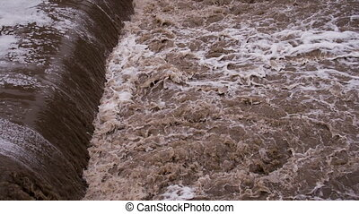 Water Destroys Road - Powerful streams of dirty water after...
