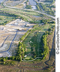 suburban sprawl - aerial view of new development with golf...