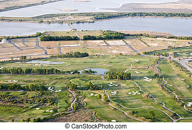 suburban sprawl - new development and golf course, aerial...