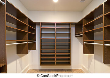 closet - large walk in closet with modular shelves