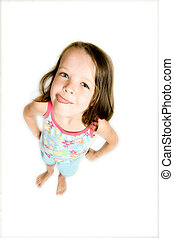 little girl with tongue out licking lips, above view, with...