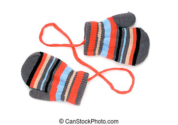 mitten - two knitted striped baby mittens isolated on white...