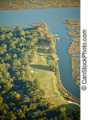 aerial view of golf course in late afternoon