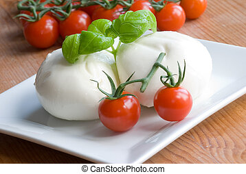 Tomato mozzarella - Loaves of mozzarella with cherry...