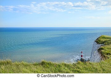 Coastline and lighthouse at Seven Sisters cliffs in England...