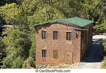 Old Millhouse in Woods - An old brick millhouse in a forest