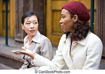 Business Women Talking - Two business women having a casual...
