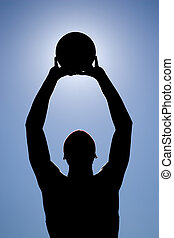 Basketball Player Silhouette - A silhouette of a young...