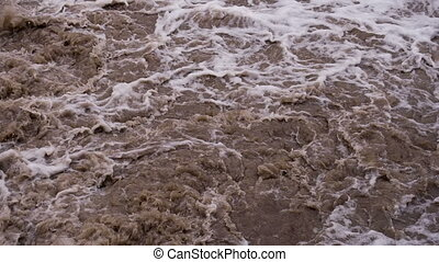Bubbling Mud Flow - Powerful streams of dirty water after...