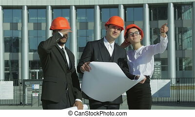 Construction of a new business center - Three confident...