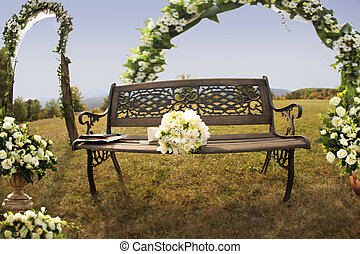 Brides bouquet on bench in nature - Brides bouquet on a...