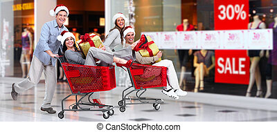 Happy couple in shopping mall.