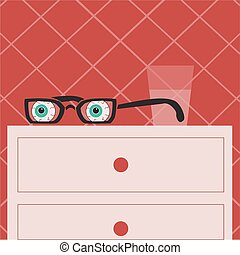 glasses with eyes lying on the bedside table