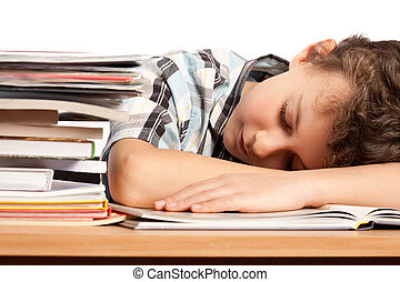Exhausted schoolboy - Portrait of a schoolboy sleeping on...