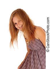 Smiling little girl bending down.