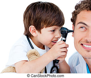 Cute child checking doctors ears at the hospital