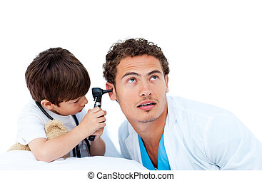 Cute little boy checking doctor\'s ears
