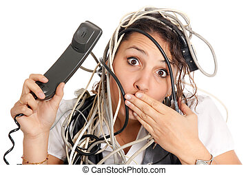 woman tangled in cables - woman lost in technology and...