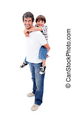 Loving father giving his son piggyback ride against a white...