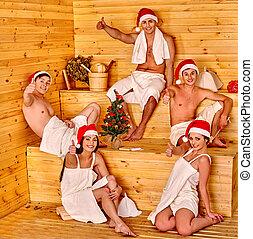 Group people in Santa hat  celebrate Christmas.