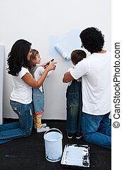 Loving parents helping their children paint