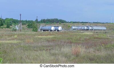 Oil storage in the country. Local electric station. Tanks...
