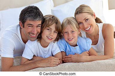 Merry family having fun in the bedroom - Merry family having...