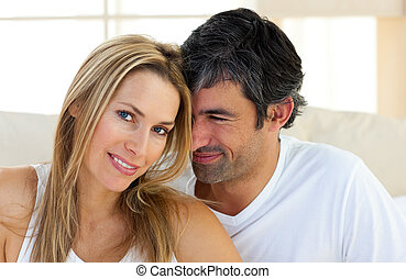 Portrait of affectionate couple in the bedroom