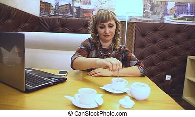 the average age of a woman thick drinking coffee in a cafe...