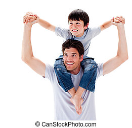 Close-up of father giving his son piggyback ride - Close-up...