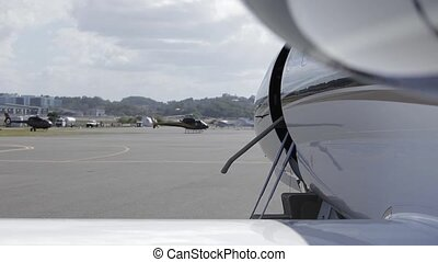 Private jet door closing - Left to right closeup pan shot of...