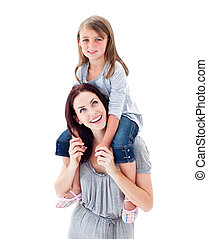 Charismatic mother giving her daughter piggyback ride...