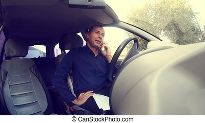 Manager businessman man driving car and talking on mobile...