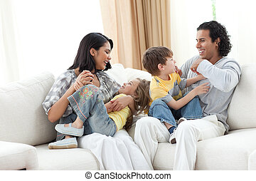 Merry family playing in the living room