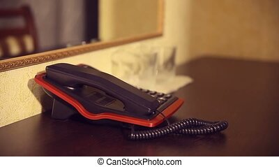 Maid woman large administrator on phone in hotel room at...