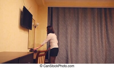 Maid woman administrator on phone in hotel room at night -...