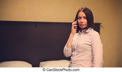 business woman talking on the phone in the room bedroom -...