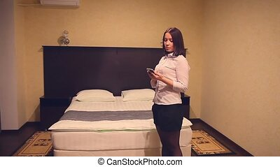 business woman talking on phone in the room bedroom -...