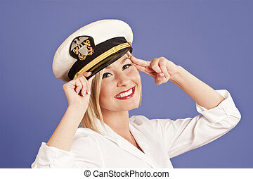 blond woman in officers cap - blond woman in generic...