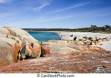 Rocks at Bay of Fires in Tasmania with beautiful sea in the background