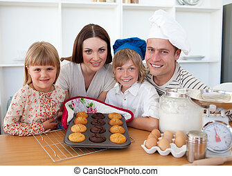 Cheerful family presenting their muffins